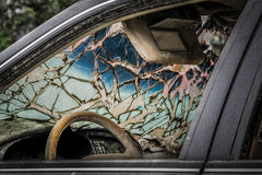 Abandoned car with broken windscreen Royalty Free Stock Photos