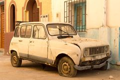 Abandoned car. Careless car on a street in Asilah, north of Morocco stock photo