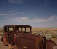 Abandoned car in the desert Stock Image
