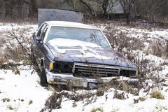 Abandoned car in a field Stock Photo