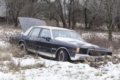 Abandoned car in a field Royalty Free Stock Image