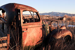 Abandoned car in field. Abandoned car in a field, late sun, rural Wyoming Stock Images