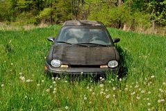 Abandoned car in field Royalty Free Stock Images