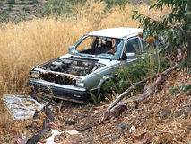 Abandoned. An abandoned car has been stripped of parts Royalty Free Stock Photo