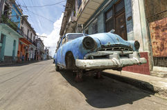 Abandoned Car in Havana, Cuba. An old american car abandoned in a street of Havana, Cuba royalty free stock photo