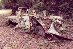 Abandoned car in the jungle Royalty Free Stock Images