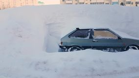 Abandoned car littered with snow parking lot in city, snowstorm. Abandoned car littered with snow in the parking lot in the city, snowstorm stock footage