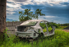 Abandoned car. In rice field Stock Image