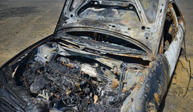 Abandoned car torched set on fire Royalty Free Stock Photography