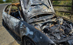 Abandoned car torched set on fire Royalty Free Stock Photo