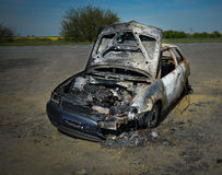 Abandoned car torched set on fire Stock Photo