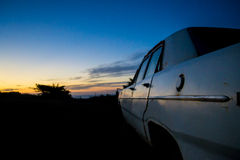 Abandoned car in the twilight. Abandoned car against the sunset at the beach Stock Images