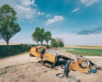 Abandoned car wreck outdoor Stock Photo