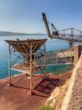 Abandoned cargo loading pier. Of bauxite mining industry royalty free stock image