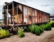 Abandoned Cargo. Went in an late afternoon hike through the industrial park of town and found this rusted container on the railroad tracks. The station had Stock Photos