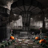 Abandoned carousel. Dark, gothic scenery with old carousel, skulls and pumpkins royalty free illustration