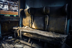 Abandoned carriage interor with seats. Closeup Royalty Free Stock Photography