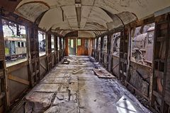 Abandoned Carriage. Abandoned train carriage with interior falling apart Stock Photo