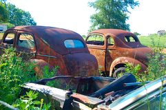 Abandoned Cars. Rusty field stock image