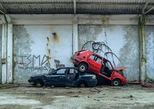 Free Abandoned Cars Stacked On Top Of Each Other Royalty Free Stock Images - 105598719