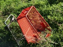 Abandoned cart, close view. Shopping cart abandoned on a weedy slope stock photo