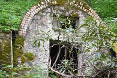 "Abandoned cellar. Abandoned stone cellar hidden in woods  "" The Fairy House& x22 Stock Photography"