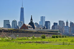 The abandoned Central Railroad of New Jersey Terminal with New York City in the background Royalty Free Stock Photos