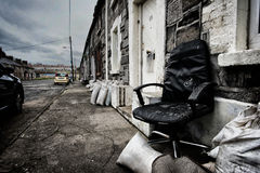 Abandoned chair in a row of houses Stock Images
