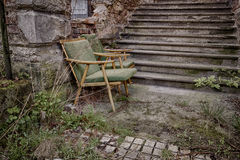 Abandoned chair. By the stairs stock photos