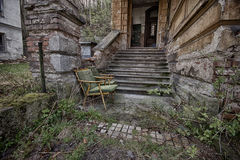 Abandoned chair. By the stairs royalty free stock images
