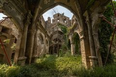 Abandoned chapel somewhere in Catalonia. Abandoned and ruined chapel in Catalonia, built on medieval age. There`s a cemetery inside stock photos