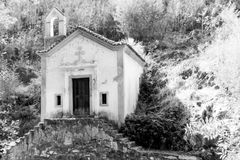 Abandoned Chapel in the Woods. In Black and White with Steps and Cross Stock Photos