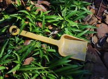 Abandoned child`s toy spade Stock Photos