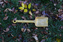 Abandoned child`s toy spade Royalty Free Stock Photos