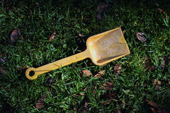 Abandoned child`s toy spade Royalty Free Stock Photography