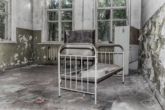 Abandoned children bed Stock Photography
