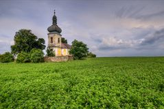 Abandoned church. In clover field above the village Stock Images