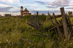 Abandoned Church. The falling fence in the background of an abandoned Church Royalty Free Stock Image