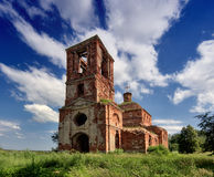 Abandoned church in field Stock Photo
