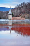 Abandoned church in the middle of a lake full with mining residu Stock Photos