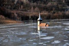 Abandoned church in a mud lake. Natural mining disaster Royalty Free Stock Image