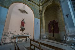 Abandoned church somewhere in Spain. Totally intact, still retains even its religious images royalty free stock photography