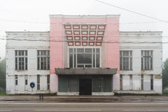 Abandoned cinema in Orel, Russia in morning haze with empty chai. R in front horizontal Royalty Free Stock Image
