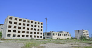 Abandoned City Buildings. Abandoned building under the blue sky Stock Images