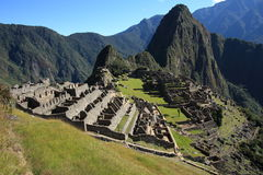 Abandoned City of Machu Picchu and Huayna Picchu mountain Stock Photo