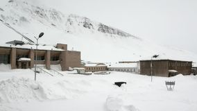 Abandoned city Pyramiden Spitsbergen Arctic. Russian neglected township. Canned place times of Soviet Union. Time stood still of North Pole stock footage