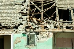 Abandoned civilian house in Eastern Ukraine damaged by grenade explosion in the war zone. Royalty Free Stock Images