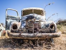 Abandoned classic car rusting in Namib desert, Namibia stock photography
