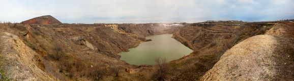 The abandoned coal mine, the village of Krasnogorsk. Panorama in cloudy weather royalty free stock photos