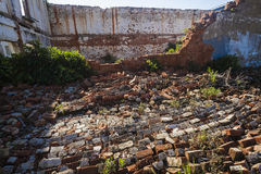 Abandoned Collapsed Building. Abandoned Condemned brick building that has collapsed with just parts of wall still standing Stock Image